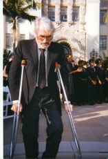 Gregory Peck, actor, on crutches