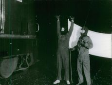 Two workers planning for a reconstruction of the train.