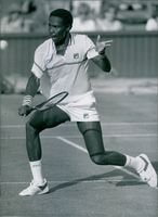 Nigerian tennis player, Nduka Odizor, in action, 1984.