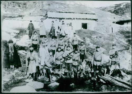 Vintage photo of Caucasian scouts from Russia with guns and tracking dogs during Russian-Japanese war in 1904-1905.