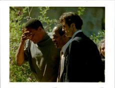 OJ Simpson, walks into his Brentwood,Calif,Estate with his friend.