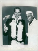 Prince Philip is welcomed by India's Prime Minister Nehru on arrival at the airport