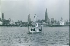 A boat sailing across the ocean. 1964