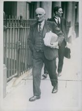 British trade unionist Arthur Pugh walking on the street with a bunch of file