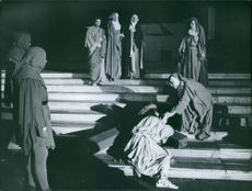 Men and woman creating drama of Jesus in Notre Dame. 1962