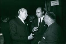 Prince Alexander talking to the other people during an event, 1960.