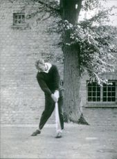 American Golfer Arnold Palmer is playing a shot