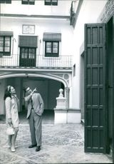 Ira Fürstenberg with Paolo Marinotti pointing her a scripture above the gate. May 17, 1967.