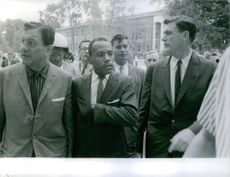 James Meredith walking with other people in 1962.