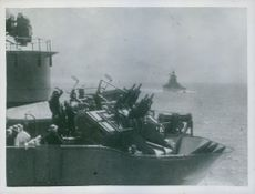 E. Boats and submarines, on a British convoy in the Mediterranean, was beaten off by the fleet and planes guarding the convoy.  Taken - Circa 1941
