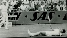 Tennis player in the back under Davis Cup 64