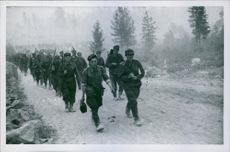 Soldiers marching on the road.