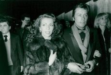 """Actor Alain Delon arrives at the premiere of """"Cocorico"""" flanked by Princess Firyal of Jordan and his girlfriend Mireille Darc"""