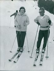 Princess Beatrix of the Netherlands and a man, skiing.