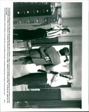 """Chevy Chase, Sam Neill, Pat Skipper and Steven Barr in """"Memoirs Of An Invisible Man""""."""