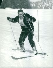 Athlete skier number 13 took a break at the end of his routines.  - Mar 1965