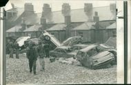 Floods 1966-1989:A pile of cars at chesil beach.
