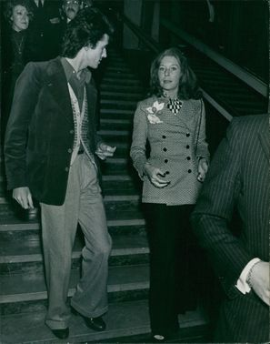 Bettina Graziani descending from staircase while a man talking to her. Photo taken on April 24, 1972.
