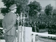An officer giving a speech to the crowd.
