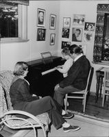 """Johan Jonatan """"Jussi"""" Björling and his wife with their son playing piano."""