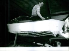 Marcel Pagnol working on boat.   1964