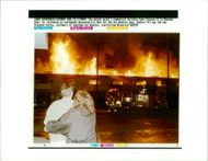 The 1994 Northridge earthquake USA: two people watch a commercial building.