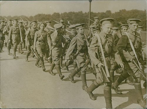 Colonial troops marching together in street, 1915.