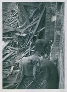War damage in February 1944 Bombs over Stockholm Explosives experts working in the ruins of what once was Eriksdalsgatan Theatre stage cottages
