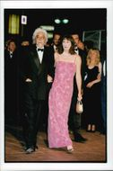 Angelica Huston with Robert Graham at the Cannes Film Festival