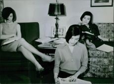 The Dee triplets reading books. 1964.