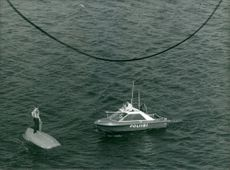 A lonely man is rescued by a police patrol boat off the Helsinki coast after his sail boat had turned upside down.
