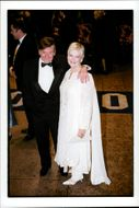 """Lady Judi Dench and her husband at the premiere of """"The world is not enough""""."""