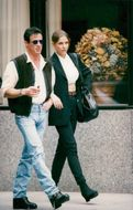 Sylvester Stallone walks with her girlfriend