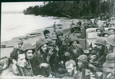 U.S. Marines, aboard trucks on their way to rest camps.