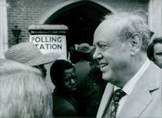 Closeup of British politician Christopher Soames, while he visiting polling both, people looking at him