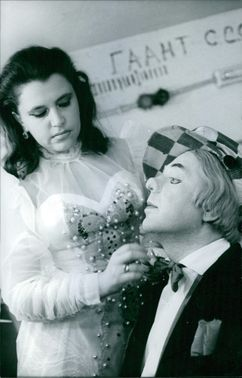 A woman applying make-up on a performer.  1967