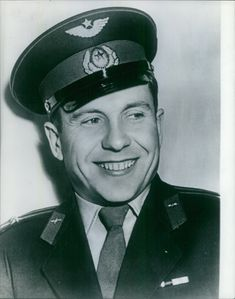 An officer smiling. August 15, 1962