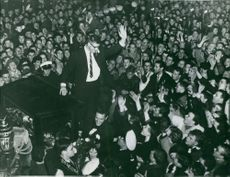 Anton Geesink surrounded by a crowd in a parade.  Taken - 11 Dec. 1961
