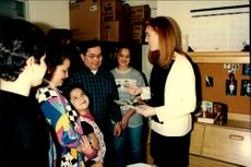 Sarah Ferguson talks with one of the families during her visit to housing for homeless people.