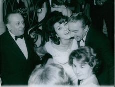 Silvana Pampanini , famous Italian actress is laughing while talking to another man.