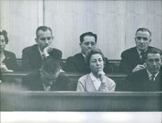 People sitting in courtroom.