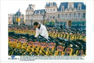 Bikes have been raised for lending outside the City Hall in Paris