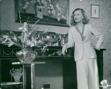 "Actress Lilian Harvey photographed indoors in his ""Elstree House""."