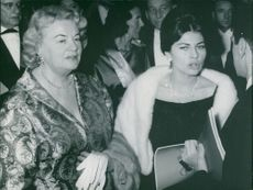 Princess Soraya of Iran talking with people in the party.  - 1963