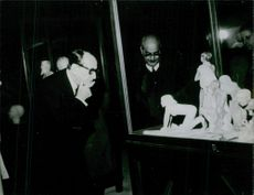 French novelist André Malraux is watching some sculpture