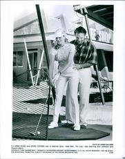 """(Left to right) Rene Russo and Kevin Costner star in the 1996 romantic comedy film """"Tin Cup""""."""