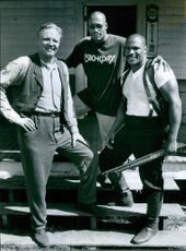 Jon Voight, John Singleton and Ving Rhames posing together and smiling on the set of movie Rosewood.
