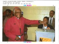 Tutu Desmond:place his vote into the ballot