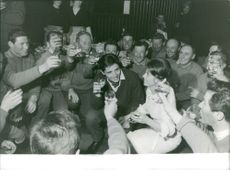 People having a toast with Sacha Distel.  Taken - 30 Jan. 1963