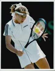 Action image on Steffi Graf taken in an unknown contest.